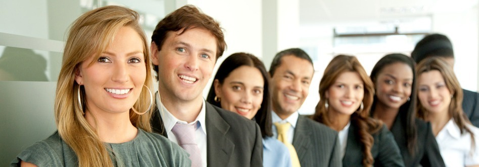 group of business people smiling in an office lined up